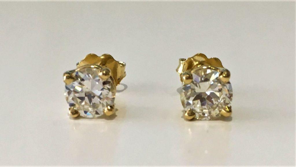 продать золотые серьги с бриллиантами